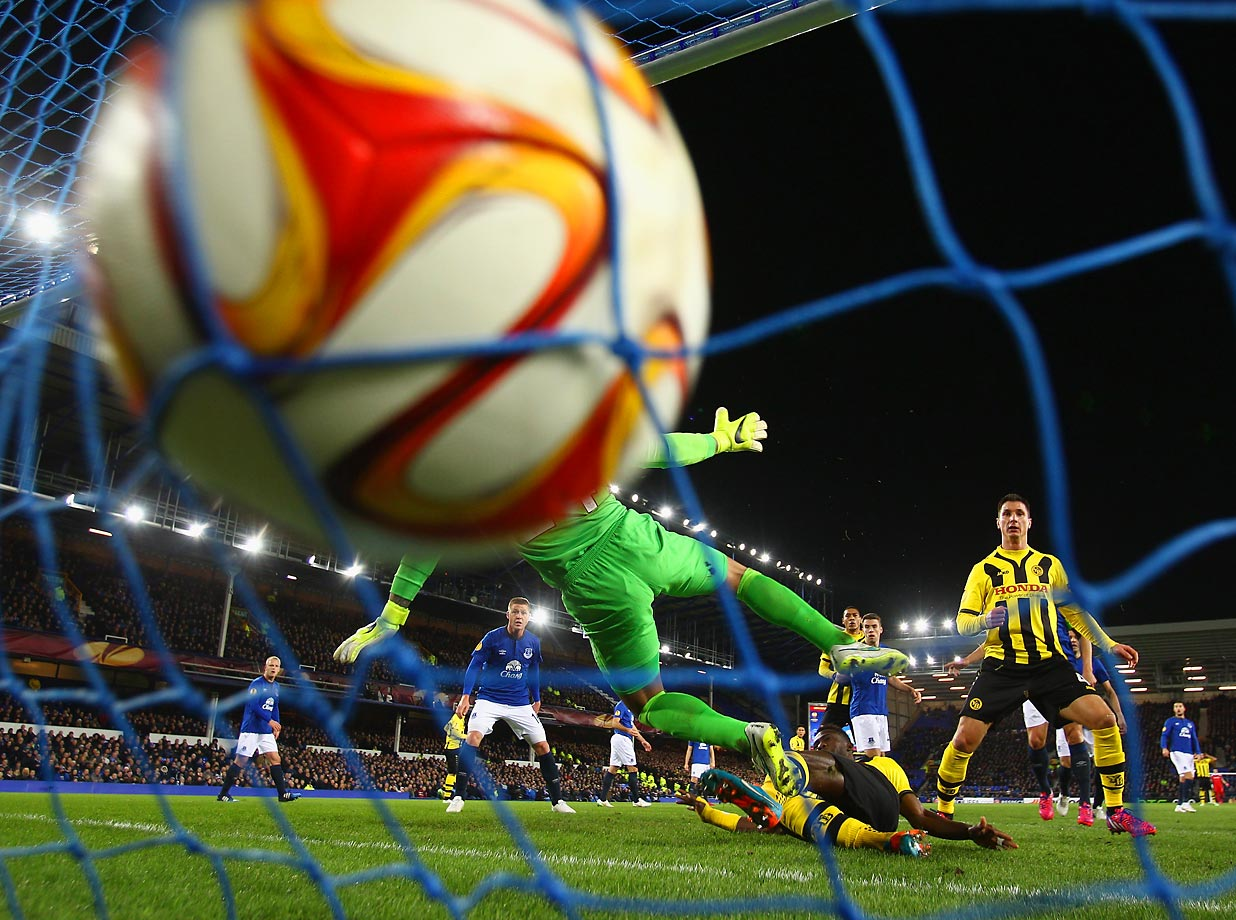 Sekou Sanogo Junior scores the opening goal past Tim Howard during the UEFA Europa League Round of 32 match between Everton FC and BSC Young Boys.
