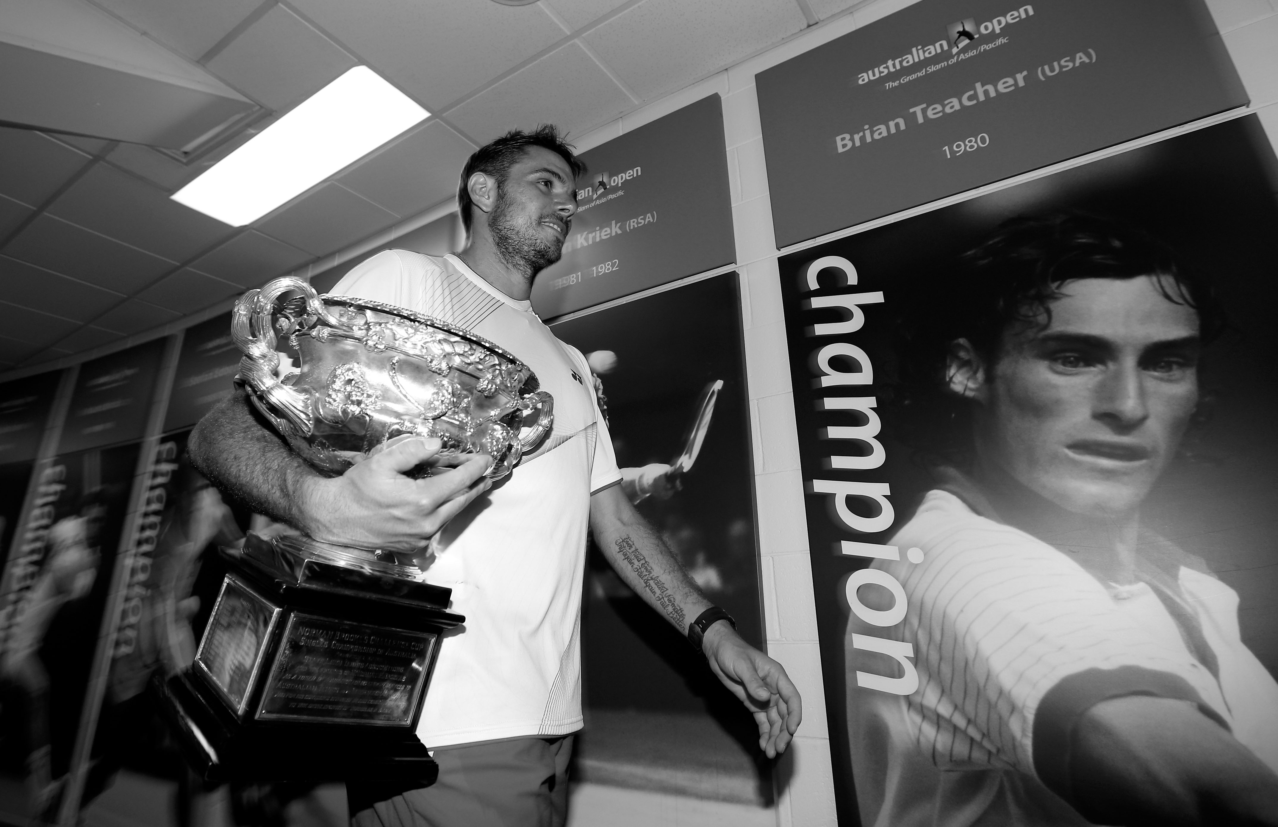 Wawrinka in front of a photo of Brian Teacher, the last man to win the Australian Open as the No. 8 seed.