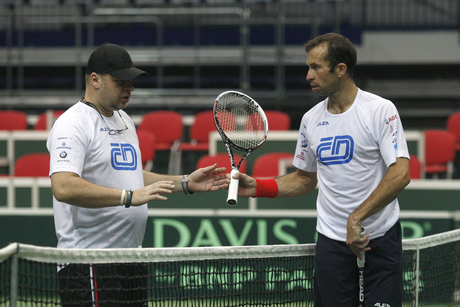 Radek Stepanek (R) of the Czech Republic is seen during a training session for the Davis Cup match on January 27, 2014 in Ostrava, Czech Republic.