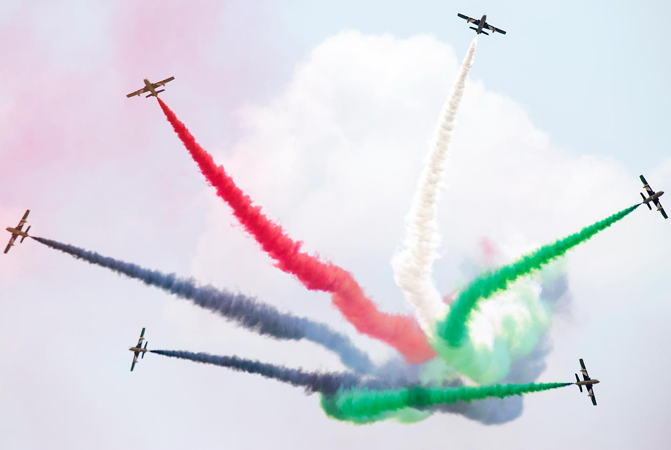 Alenia Aermacchi SpA MB-339 aircraft, operated by the United Arab Emirates Air Force's Al Fursan team, perform at the Langkawi International Maritime And Aerospace Exhibition in Langkawi, Malaysia.