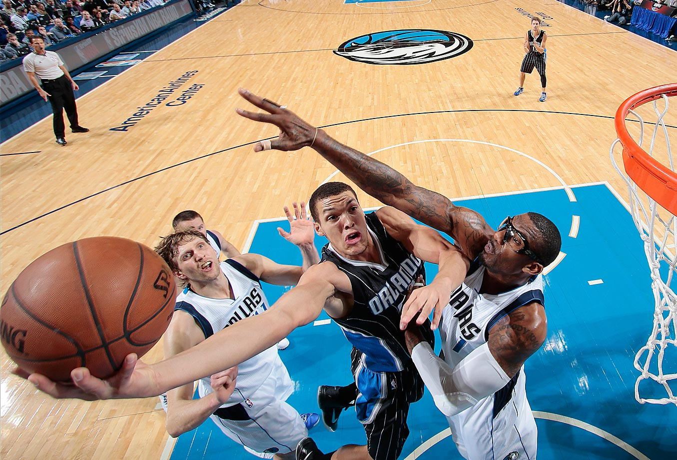 Aaron Gordon of the Orlando Magic goes in for the lay up against Amare Stoudemire of the Dallas Mavericks.