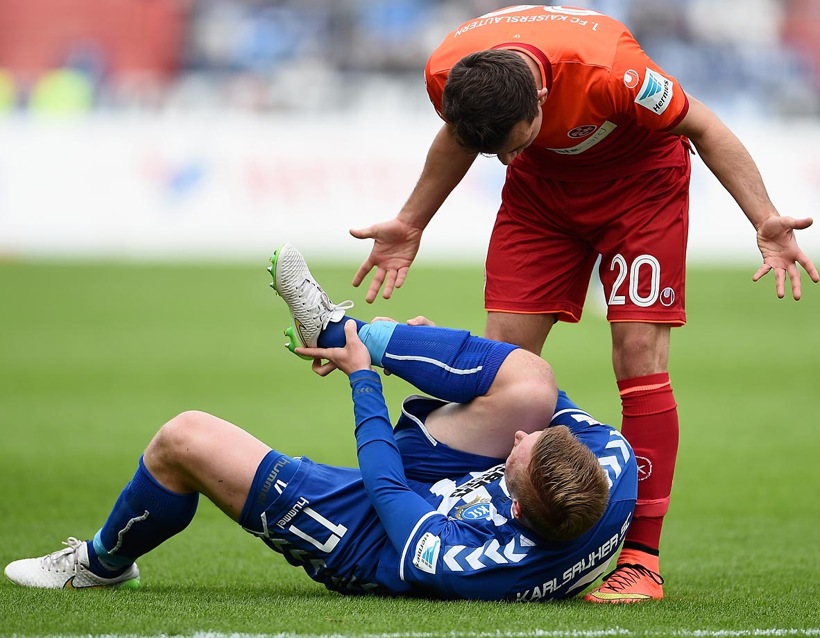 Kevin Stoeger of 1. FC Kaiserslautern with Rouwen Hennings of Karlsruher SC during the second Bundesliga match between Karlsruher SC and 1. FC Kaiserslautern.