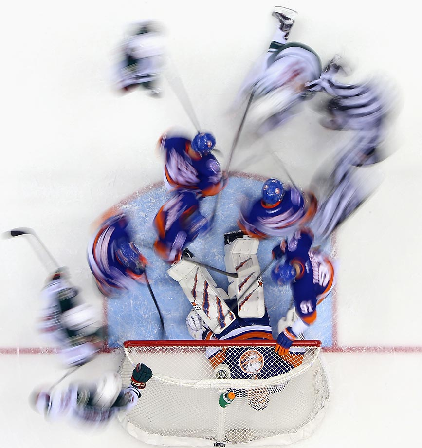 New York Islanders goalie Jaroslav Halak covers the puck amidst a swirl of bodies during the second period of the team's 2-1 loss to the Minnesota Wild at Nassau Veterans Memorial Coliseum last week.