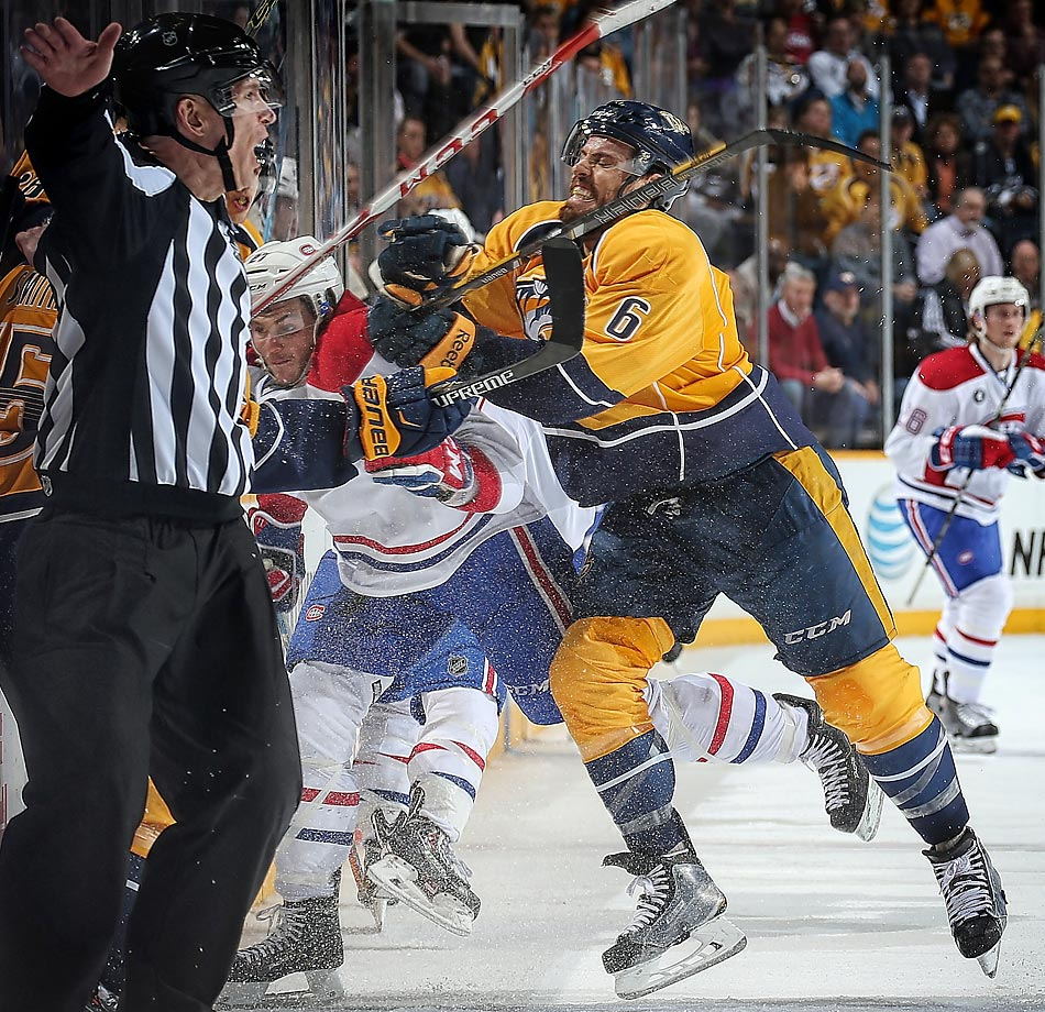 Nashville Predators defenseman Shea Weber finishes a check against the Montreal Canadiens' Alex Galchenyuk during a battle of teams that ended the week in first place. The Predators earned a 3-2 overtime win in Nashville for the second of four straight victories.