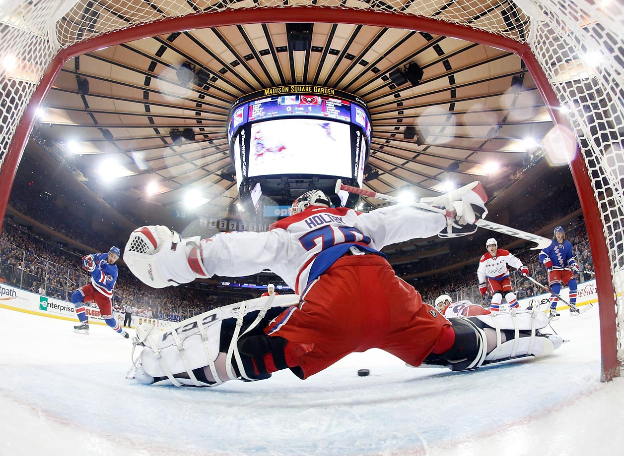 Kevin Hayes of the New York Rangers shoots the puck at Washington Capitals goalie Braden Holtby at Madison Square Garden on Sunday. Holtby and the Captials prevailed 5-2.