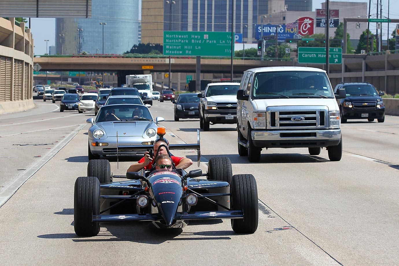 Verizon IndyCar Series driver Ed Carpenter drives an INDYCAR on a highway in the Dallas/Fort Worth, Texas, area on June 3 with Jeff Cavanaugh of GBAG Nation and co-host of KRLD-105.3 The Fan.