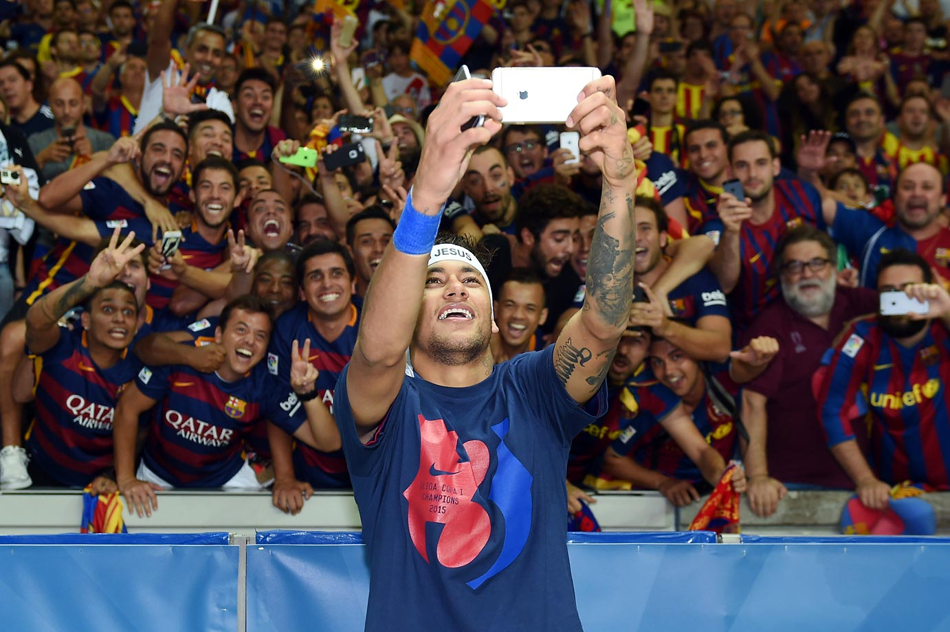 Neymar da Silva Santos Jr. of Barcelona poses for a selfie with fans following his team's victory over Juventus in the UEFA Champions League Final on June 6 in Berlin.