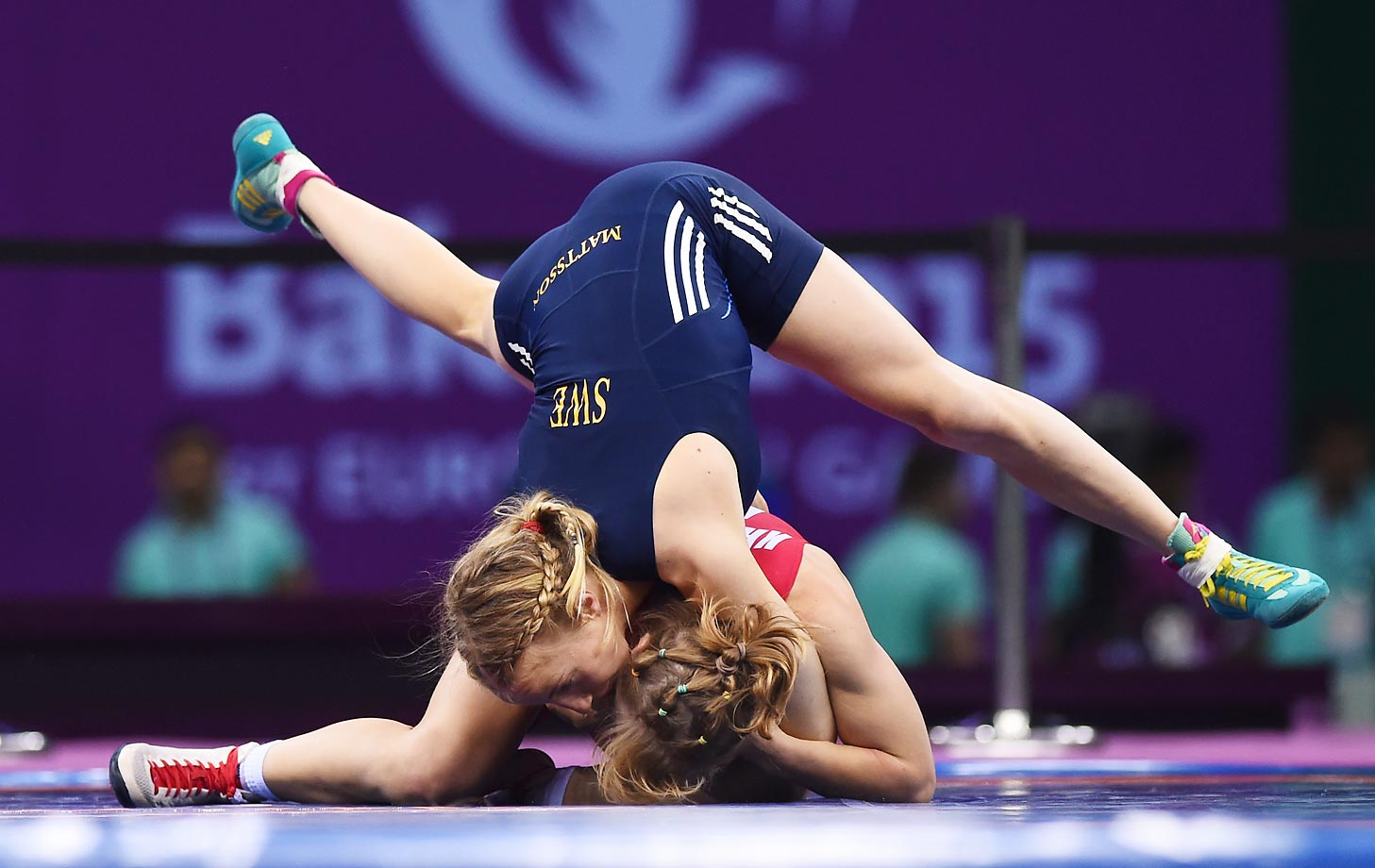Sofia Mattsson of Sweden (blue) and Katarzyna Krawczyk of Poland compete in the 55kg Freestyle Wrestling final at the Baku 2015 European Games.