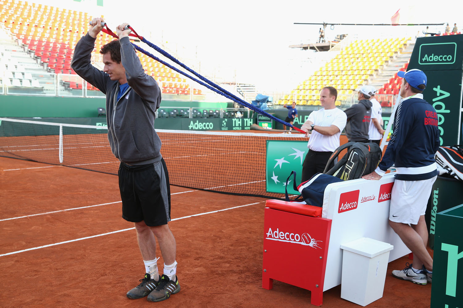 Andy Murray warms up for a late practice session watched by his team captain Leon Smith prior to the Davis Cup World Group Quarter Final match between Italy and Great Britain at Tennis Club Napoli in April 2014.