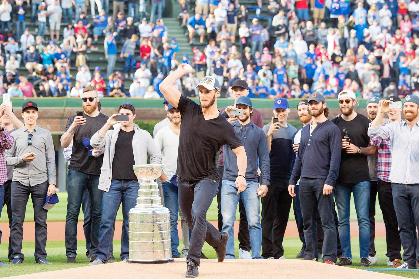Jonathan Toews of the Stanley Cup champion Chicago Blackhawks throws out the ceremonial pitch at a game between the Cleveland Indians and the Chicago Cubs.