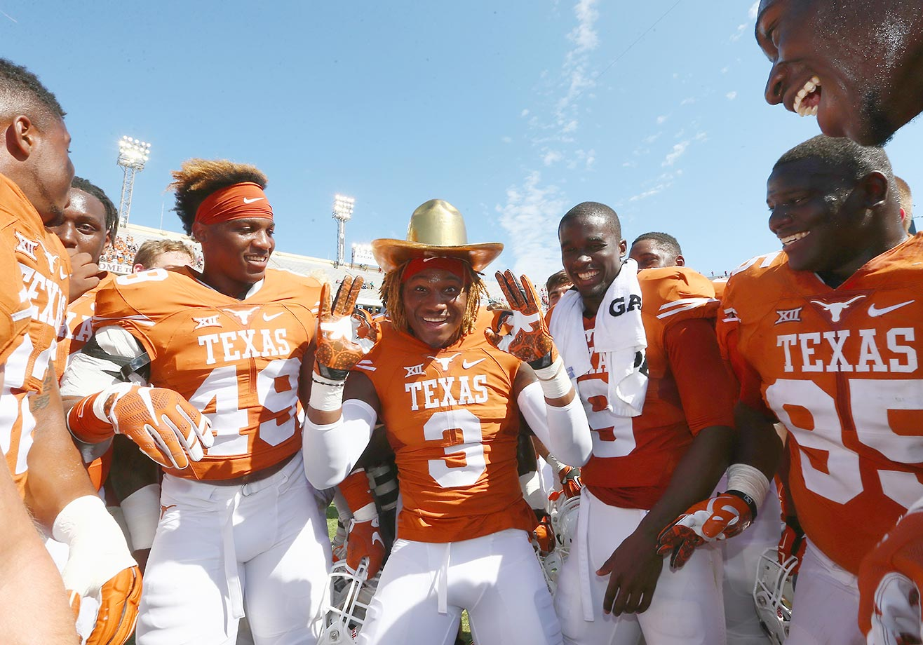 Armanti Foreman of Texas celebrates with the Golden Hat trophy after a 24-17 upset victory over Oklahoma.