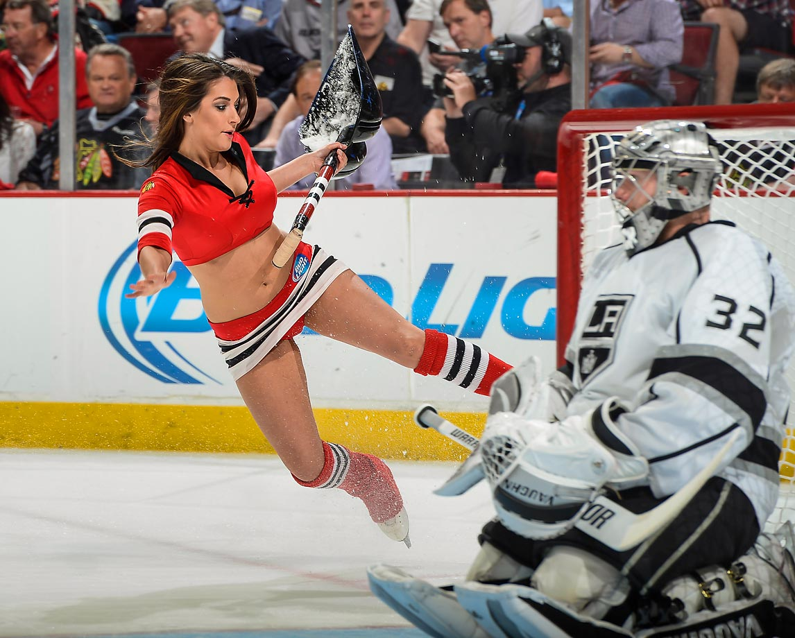 A Chicago Blackhawks Ice-Crew girl slips next to goalie Jonathan Quick in Game 2 of the Western Conference Final.