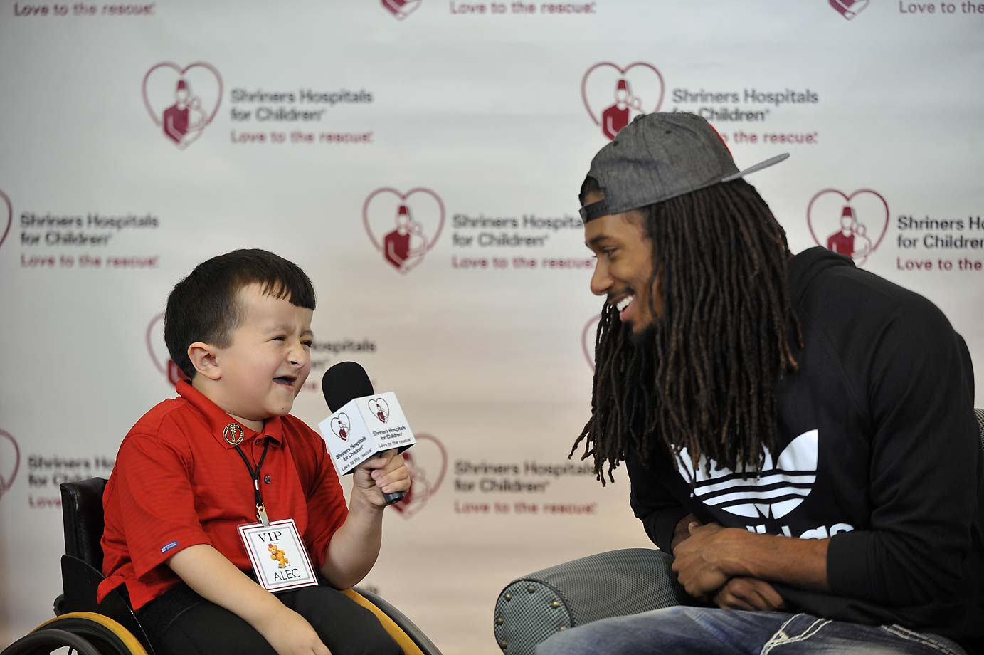 NFL prospect Trae Waynes of Michigan State talks to pediatric patient Alec Cabacungan while doing a mock interview during the NFL PLAY 60 activities at Shriners Hospital for Children on Thursday, April 30 in Chicago.