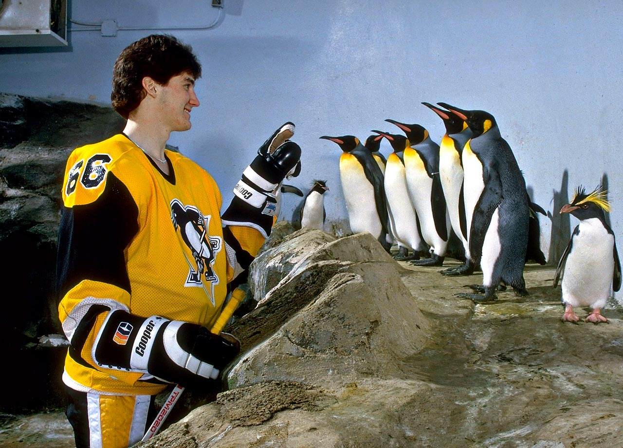 Pittsburgh Penguins captain Mario Lemieux doles out line assignments to a few honorary teammates.