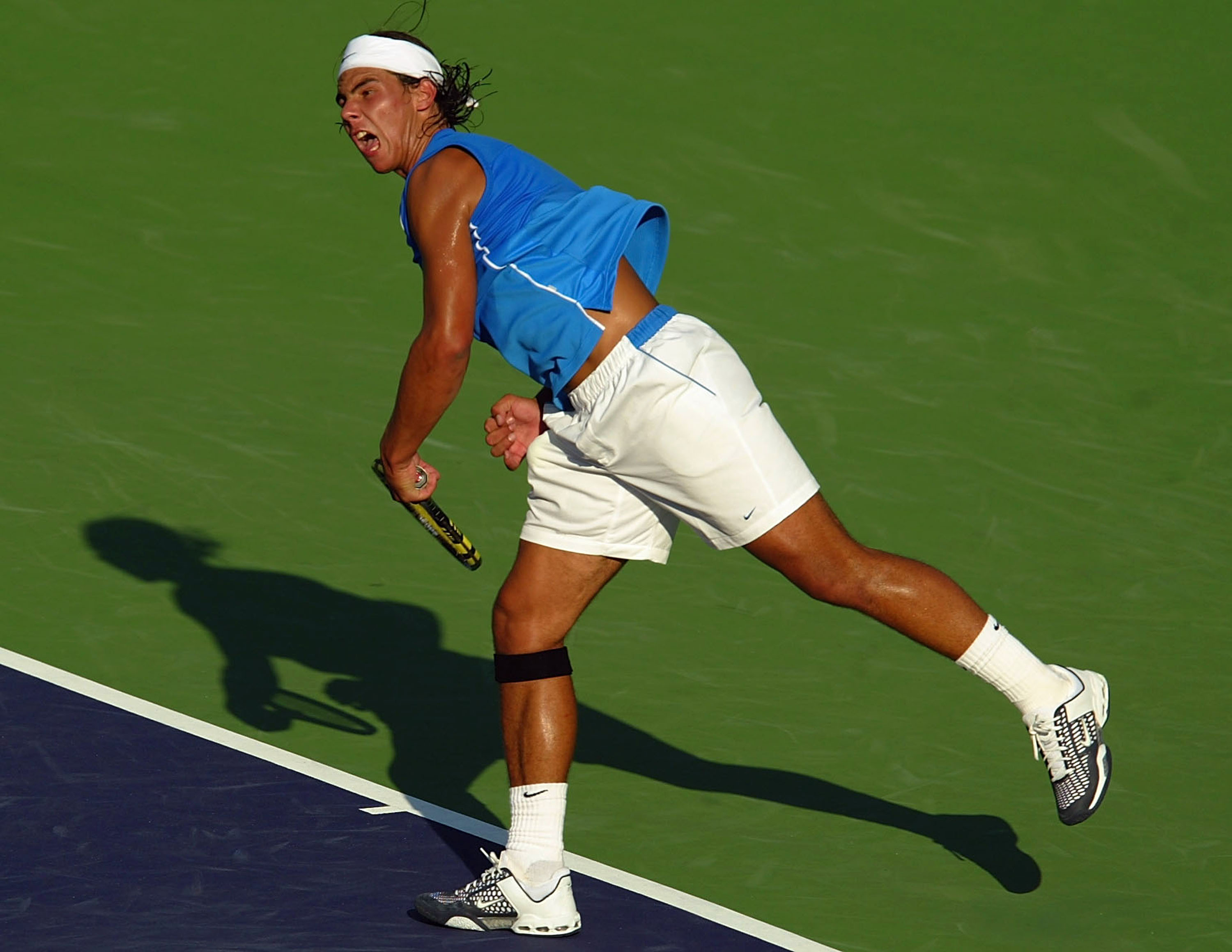 Nadal continues the aggressive look of his soon-to-be signature sleeveless shirt and makes his transformation into a style icon.