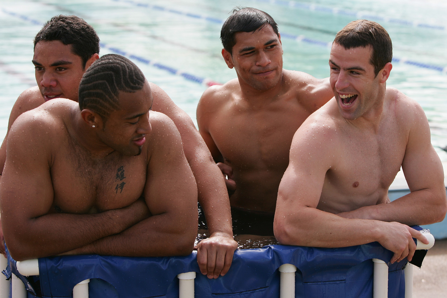 From left to right, Australian rugby footballers Willie Tonga, Roy Asotasi, Matt Utai and Luke Patten of the Bulldogs share a laugh while enjoying an ice bath together.