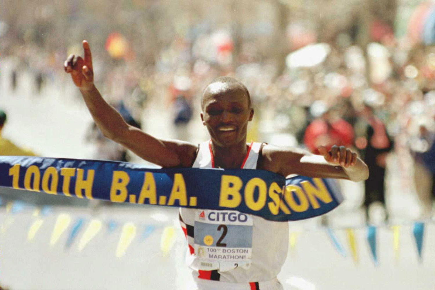Moses Tanui crosses the finish line to win the men's division in the 100th running of the Boston Marathon.