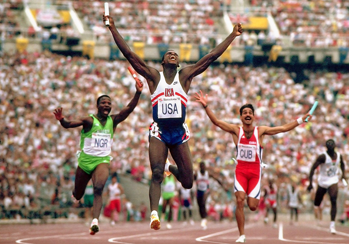 Summer Olympics, Aug. 8, 1992 | U.S. sprinter Carl Lewis celebrates after winning the gold medal and setting the new world record in the 4x100-meter relay. Lewis' final leg, which he covered in 8.85 seconds, stood as the fastest anchor leg on record until 2007.