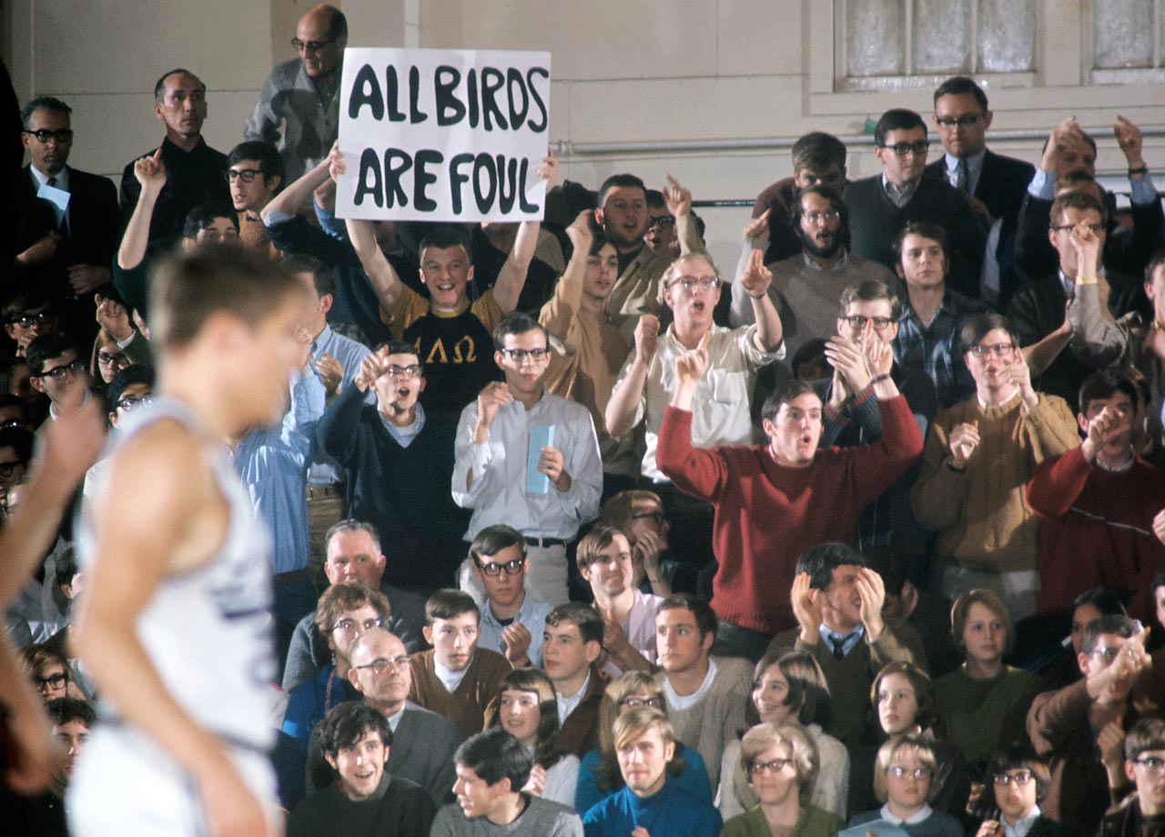 A Kenyon College basketball fan holds a sign mocking the opposing Otterbein Cardinals in 1968. Fan signs have since become significantly more crass, but this one reminds us that a good wordplay can be timeless.