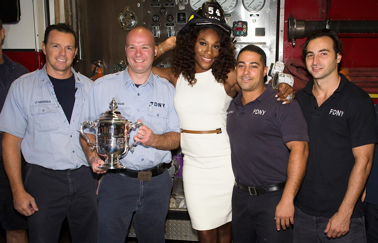 Serena poses with members of Engine 54 Ladder 4 Battalion 9 in New York the day after winning the U.S. Open.