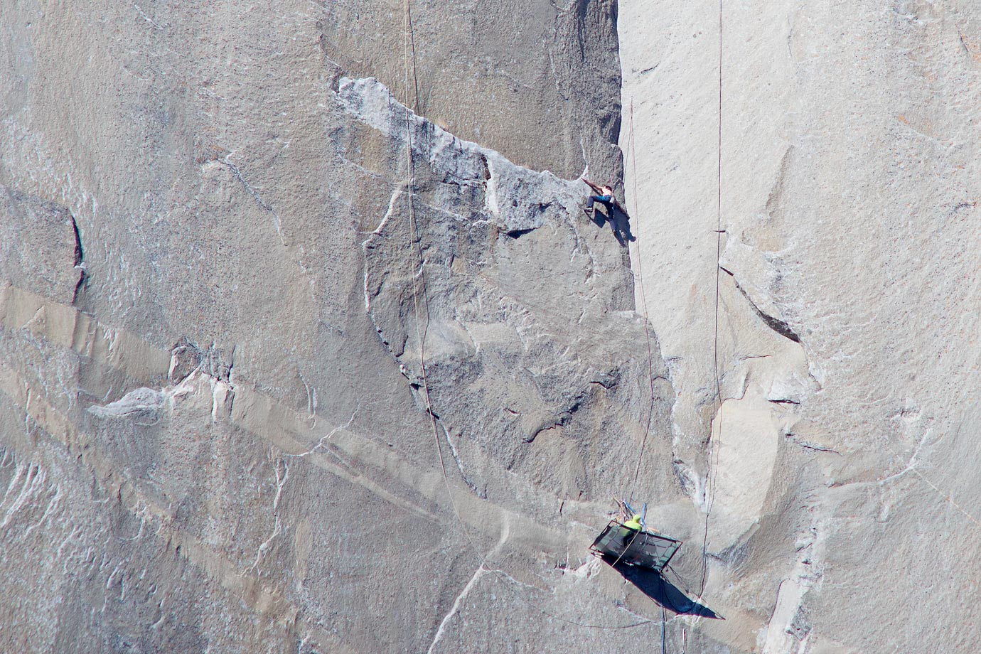 Kevin Jorgeson (shirtless) climbing the top of Pitch 17 while Tommy Caldwell (in yellow) belays below.