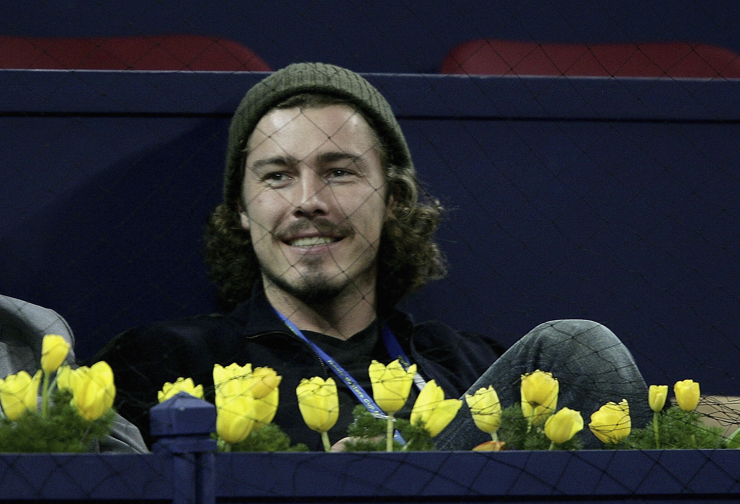 Marat Safin of Russia watches Andre Agassi during his match against Nikolay Davydenko.