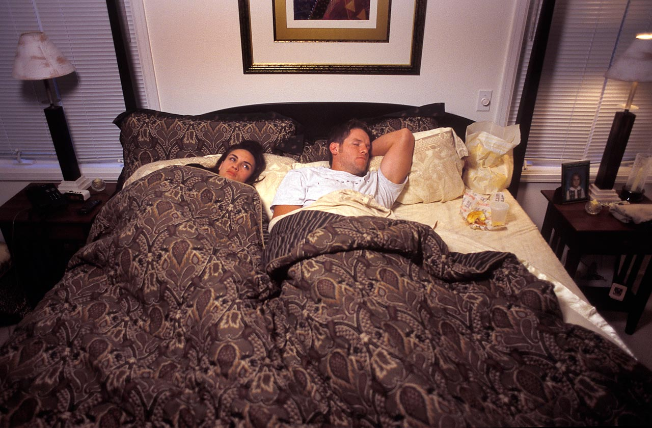 Brett Favre falls asleep halfway through his in-bed fast food meal, much to the chagrin of wife Deanna.