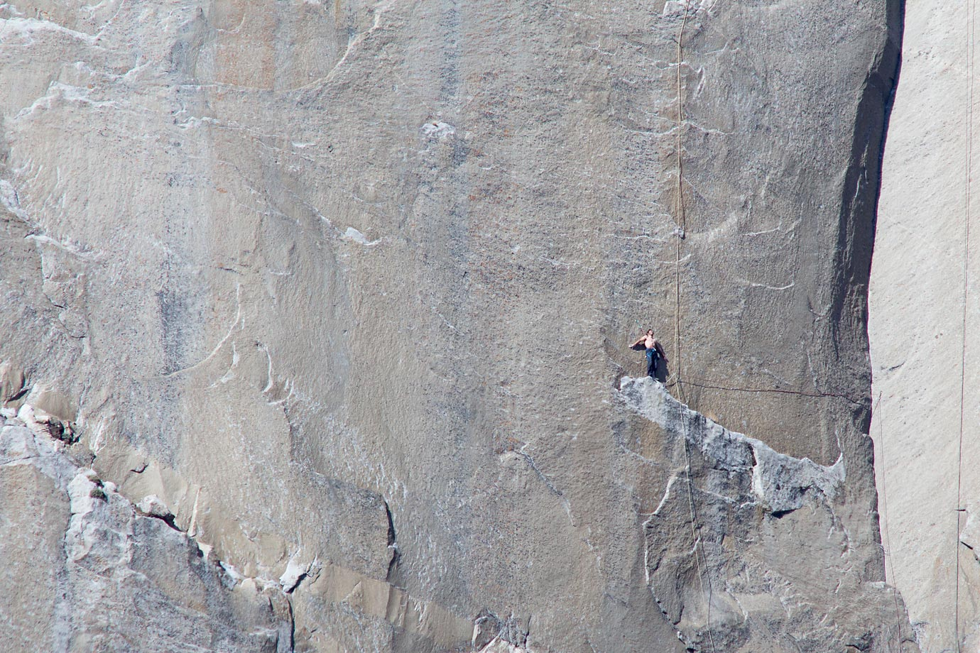 Kevin Jorgeson (shirtless) stands at the beginning of Pitch 18 looking up.