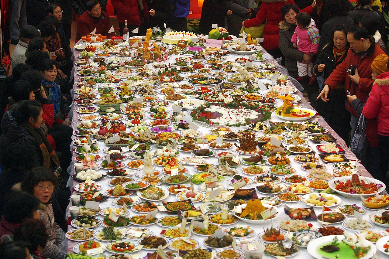 The 8,146 dishes made by different families were gathered and displayed in Wuhan city, China, to celebrate the Chinese Spring Festival.