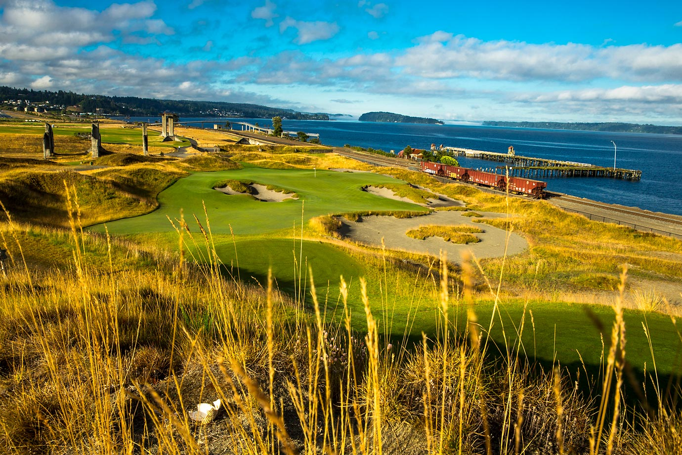 The 17th hole at Chambers Bay is a breathtaking par 3 along the water with an active rail line running alongside it, which fits its nickname,'Derailed'.