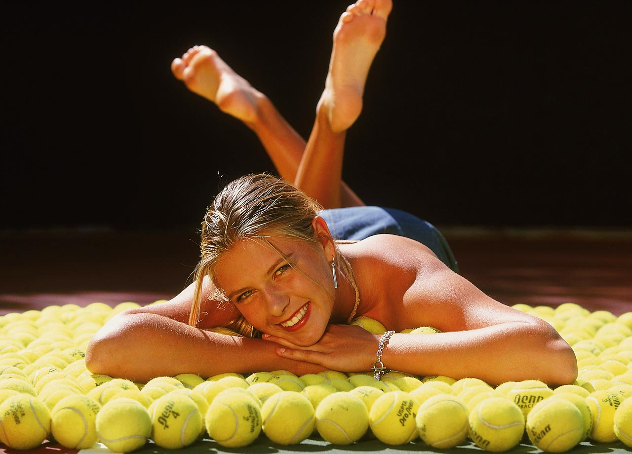 Sharapova lays out on a carpet of tennis balls before playing in Indian Wells.