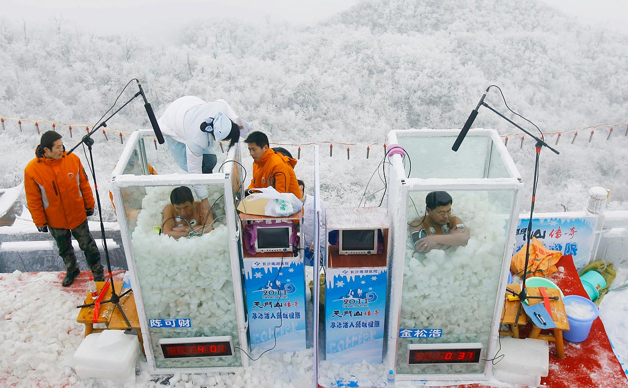 Chen Kecai (left) and Jin Songhao compete in a cold endurance competition on the Tianmen Mountain in Zhangjiajie, China. Jin won with a time of 120 minutes.
