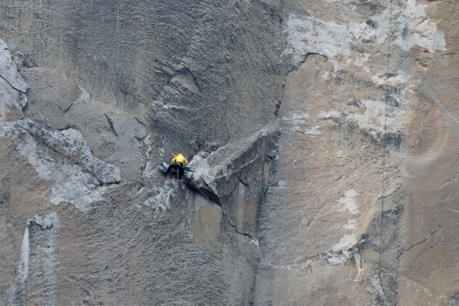 Tommy Caldwell (in yellow) breaking down the Portaledge to move it to the next pitch.