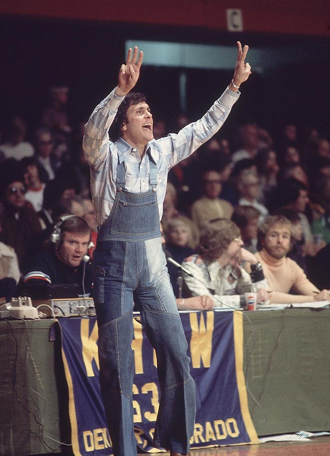 A beacon of professionalism, Denver Nuggets coach Larry Brown sports a denim overall ensemble during a 1975 game against the Pacers.