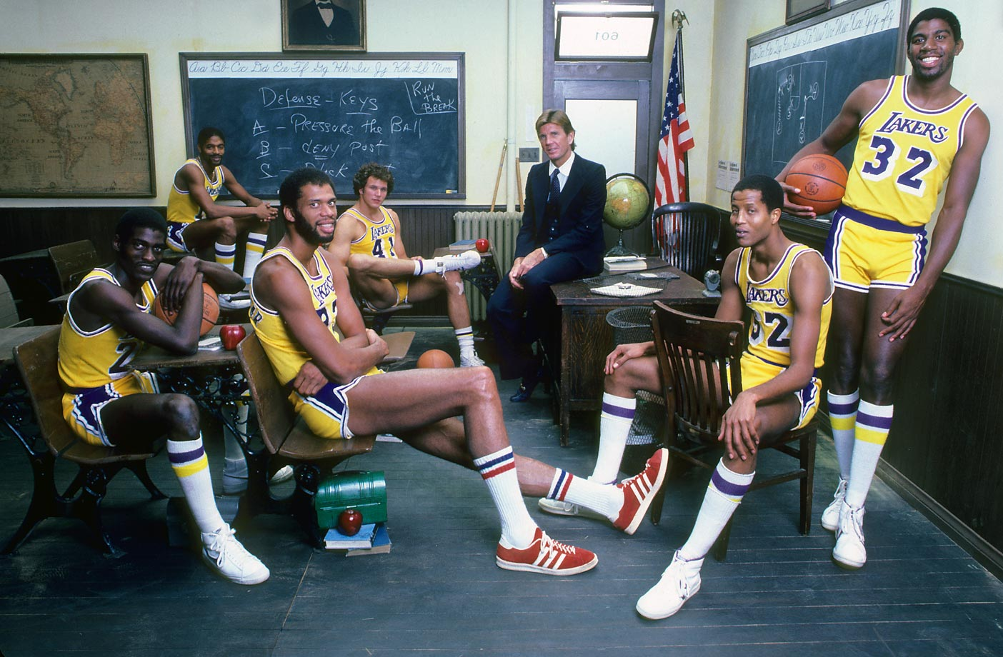 "The 1981-82 Los Angeles Lakers cram into a classroom for an SI photo shoot. The ""Showtime"" crew would spend the entire season schooling their opponents, cruising to an NBA championship over the Philadelphia 76ers."