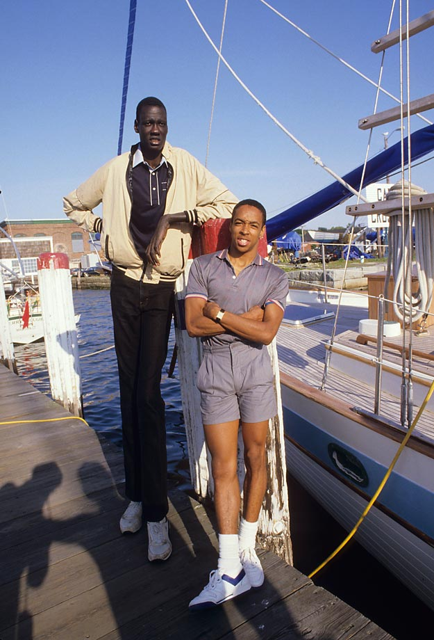 Spud Webb and Manute Bol gear up for a pleasant day out on a rowboat -- Webb as the captain, Bol as the oar. Webb, one of the shortest players in NBA history at 5-foot-7, was a teammate of Bol's on the United States Basketball League's Rhode Island Gulls in 1985.