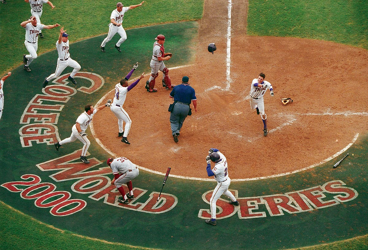 College World Series, June 17, 2000 | LSU shortstop Ryan Theriot tosses his helmet in celebration after scoring the game-winning run in the 2000 College World Series. LSU rallied from a three-run deficit to top the Stanford Cardinal 6-5 at Rosenblatt Stadium in Omaha, Neb.