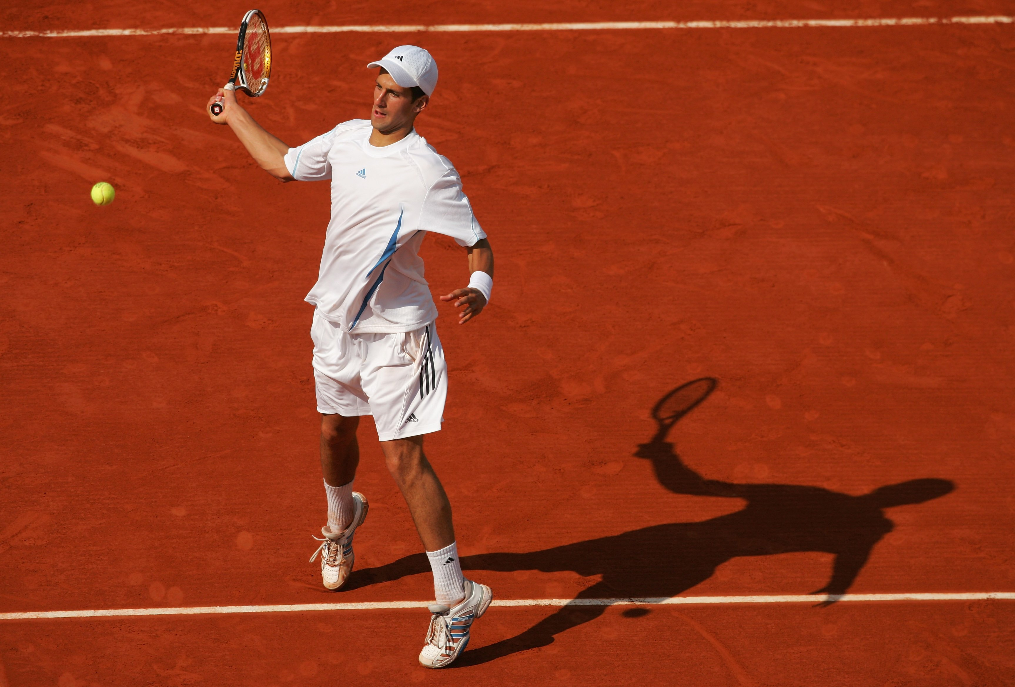 For a player who is known now for snug-fitting attire, it's easy to forget how billowy it once was, at the French Open.