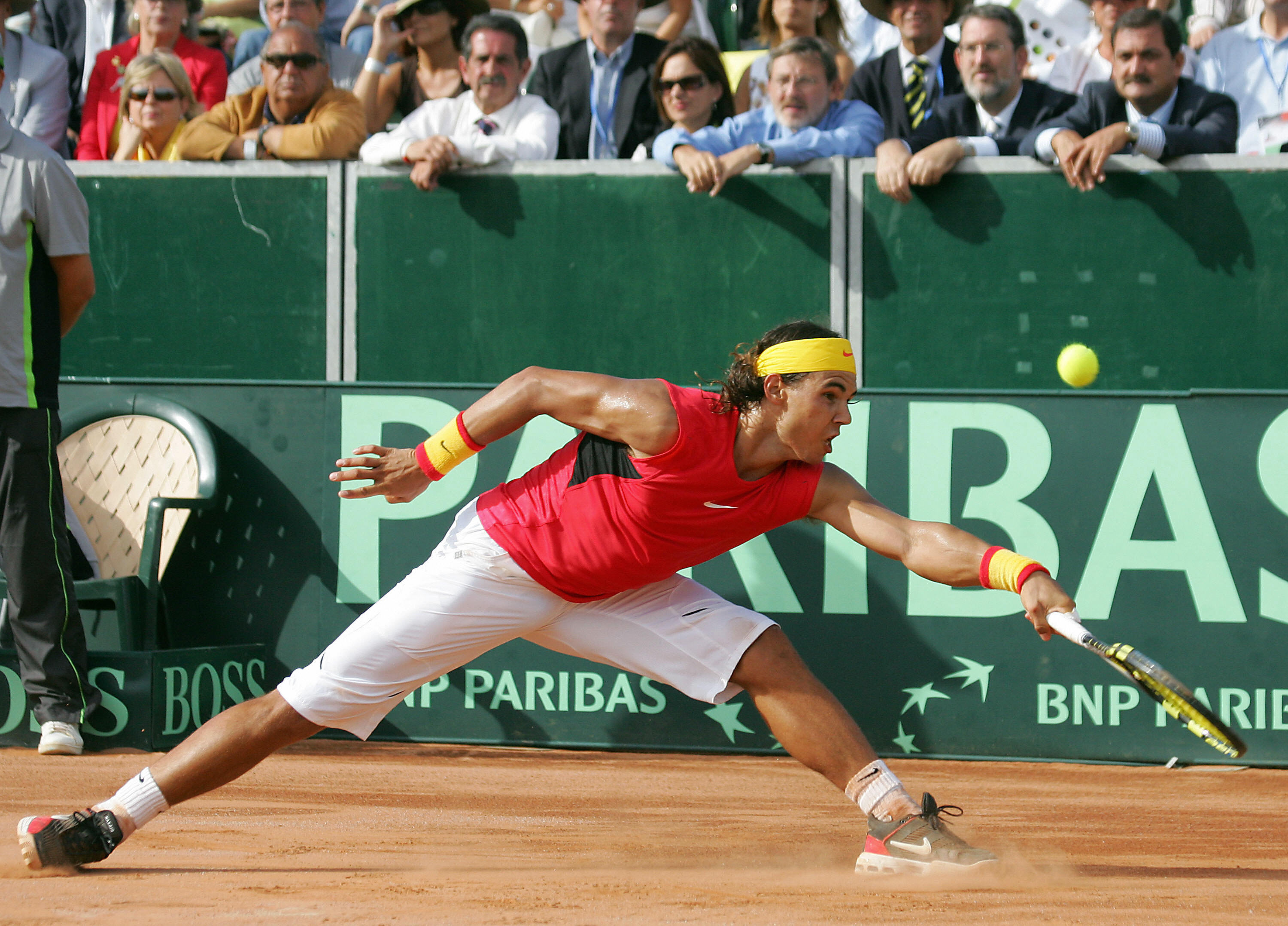 Nadal embodies his country's colors with this red and yellow ensemble as he represented Spain at the Davis Cup.