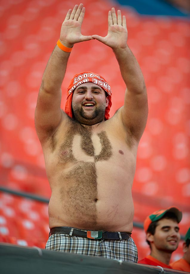 Few fans made our list of 100 funniest photos, and this guy was one of them. A quick look at his chest reveals why.