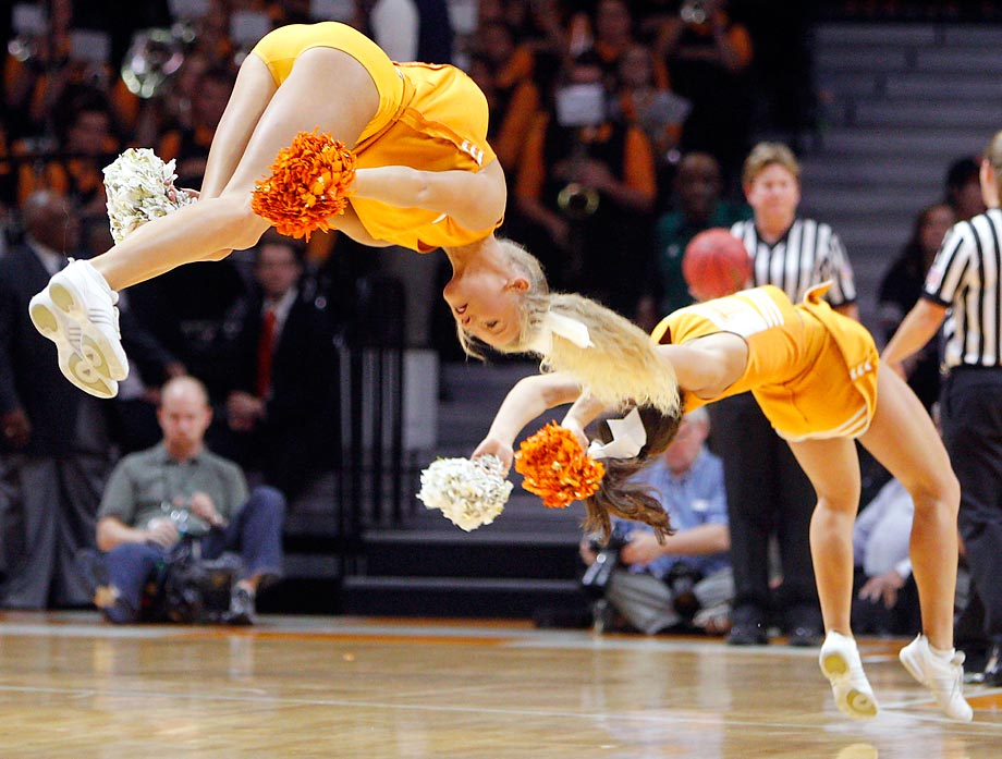 Tennessee cheerleaders doing flips at Sunday's game.