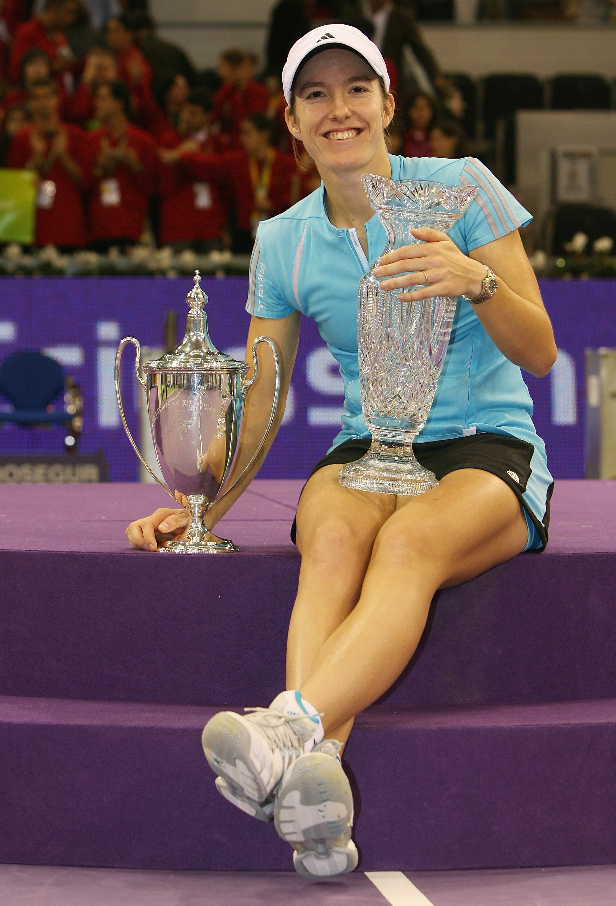Justine Henin wins her first WTA Finals title and finishes the year No. 1.