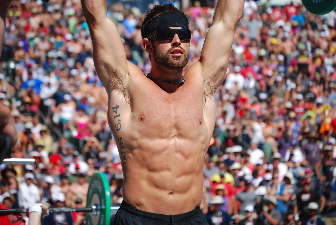 Froning is the only man to win the Games three times, with first place finishes in the 2011, 2012 and 2013 Games. He played college baseball and is looking to defend his title this year.