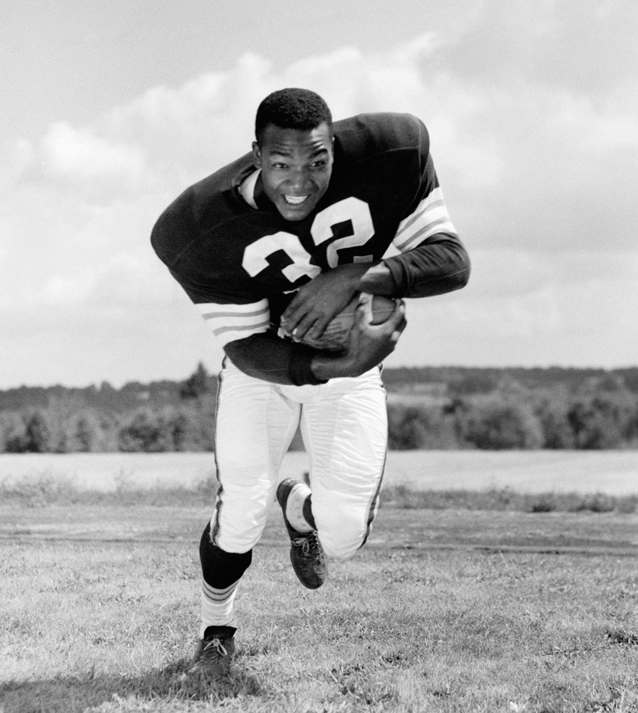 The legendary Jim Brown poses for an action portrait during Cleveland Browns training camp in July 1957 at Hiram College.