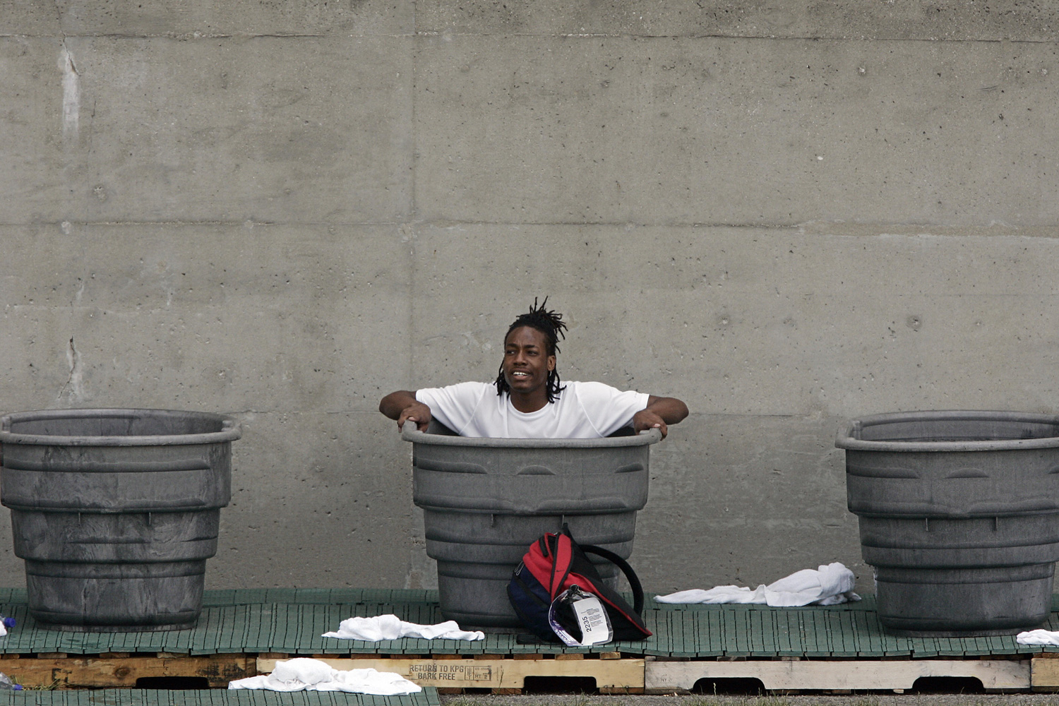 An athlete cools down in tubs full of ice during the 2007 AT&T US Outdoor Track and Field Championships at Mike Carroll Stadium in Indianapolis.