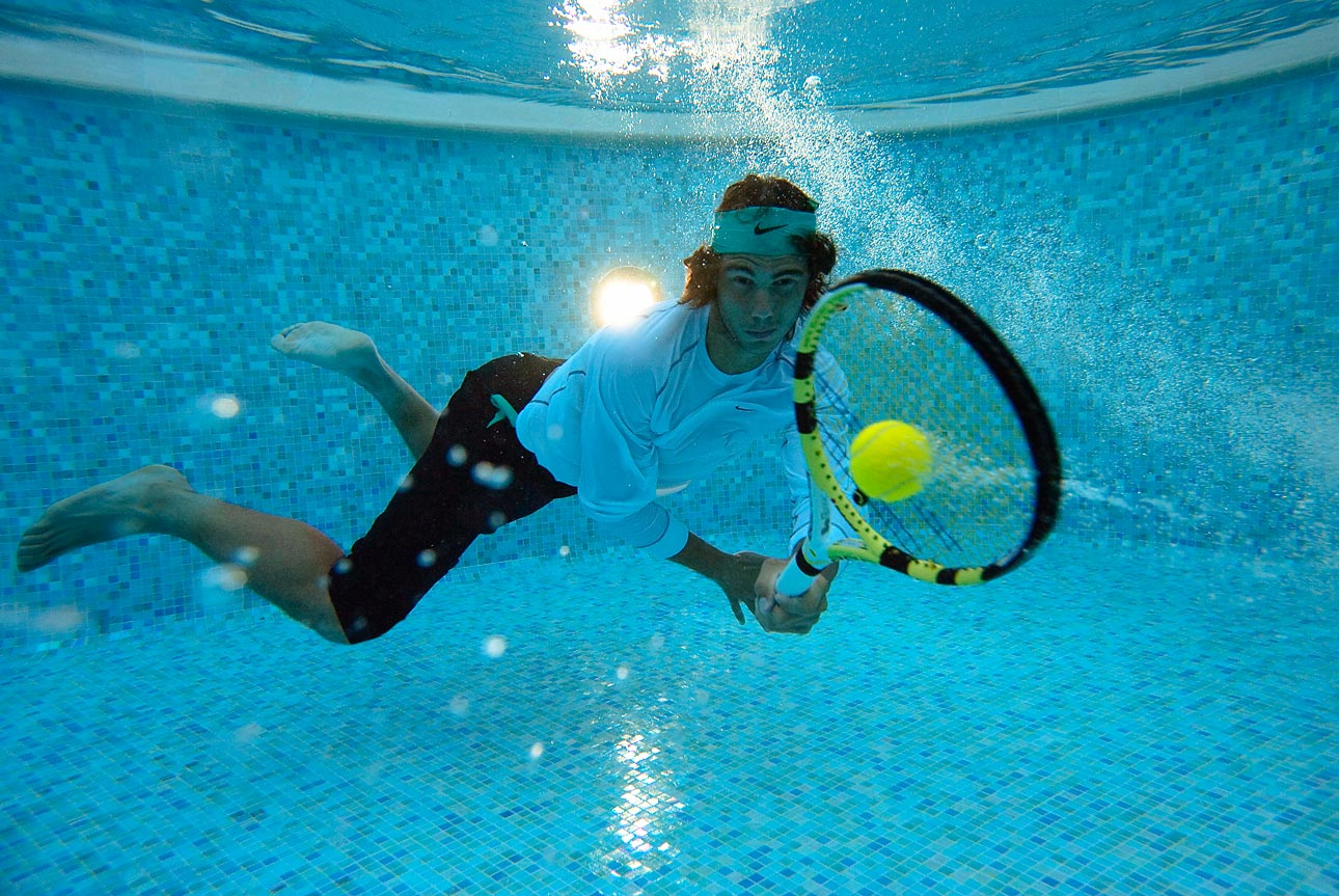 Tennis pro Rafael Nadal of Spain takes a dive in 2007.