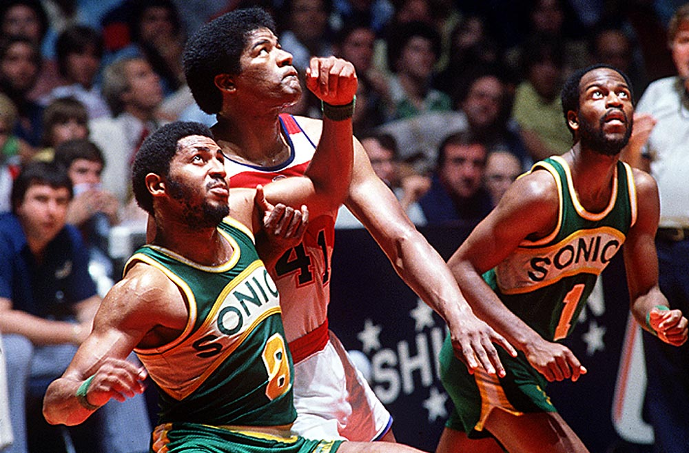 Lonnie Shelton of the Sonics battles Wes Unseld of the Bullets during the 1979 Finals. Unseld led Washington to a title over Seattle the previous year, but the Sonics stuck this one out behind their high-scoring backcourt of Gus Williams and Dennis Johnson.