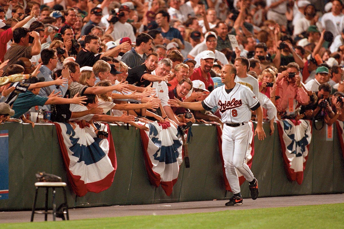 Angels at Orioles, Sept. 6, 1996   Baltimore Orioles fans congratulate shortstop Cal Ripken, Jr. shortly after he breaks Lou Gehrig's consecutive games played record. Ripken would end his own streak at 2,632 games in 1998, surpassing Gehrig's record by 502 games.