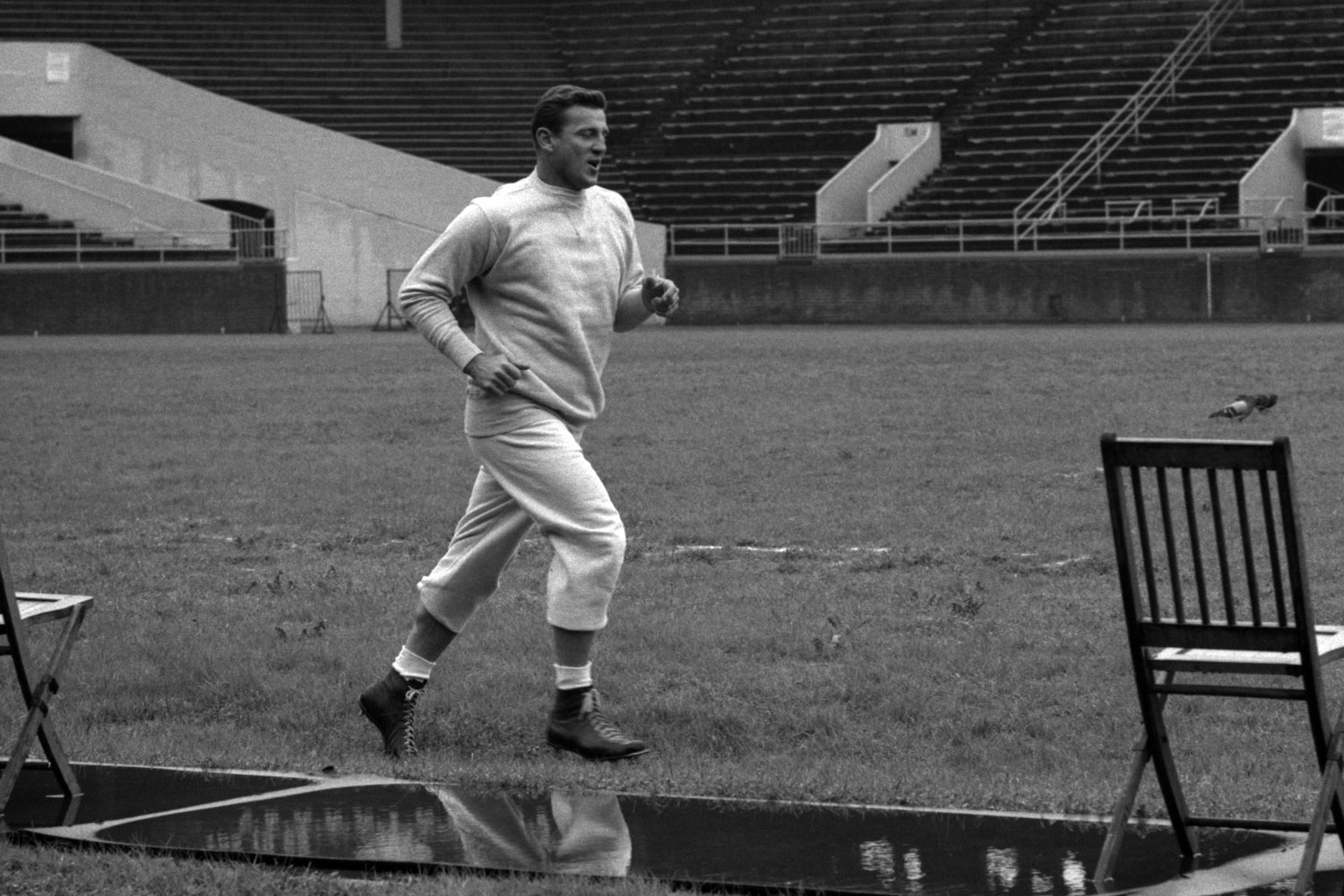 Philadelphia Eagles linebacker Chuck Bednarik jogs around the field prior to a practice in 1960 at Franklin Field in Philadelphia.