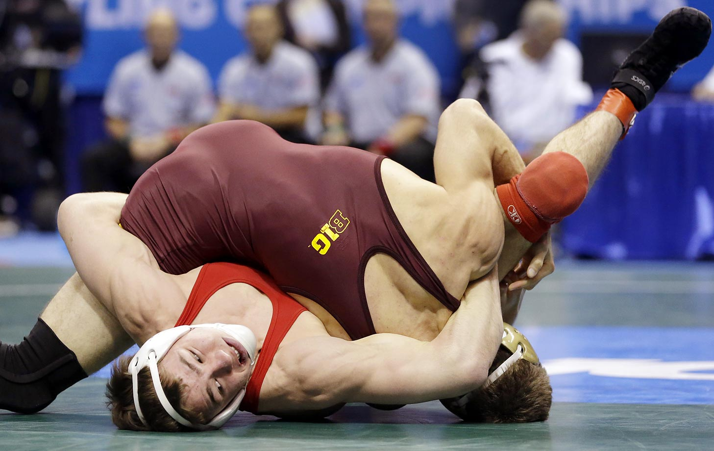 Cornellís Brian Realbuto (right) wrestles with Minnesota's Dylan Ness during their 157-pound semifinal match at the NCAA Division I Wrestling Championships in St. Louis.